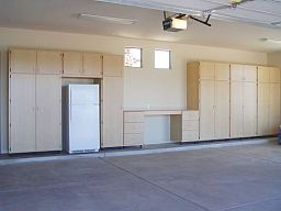 large wall unit custom combination of various sizes of garage cabinets built around a freezer